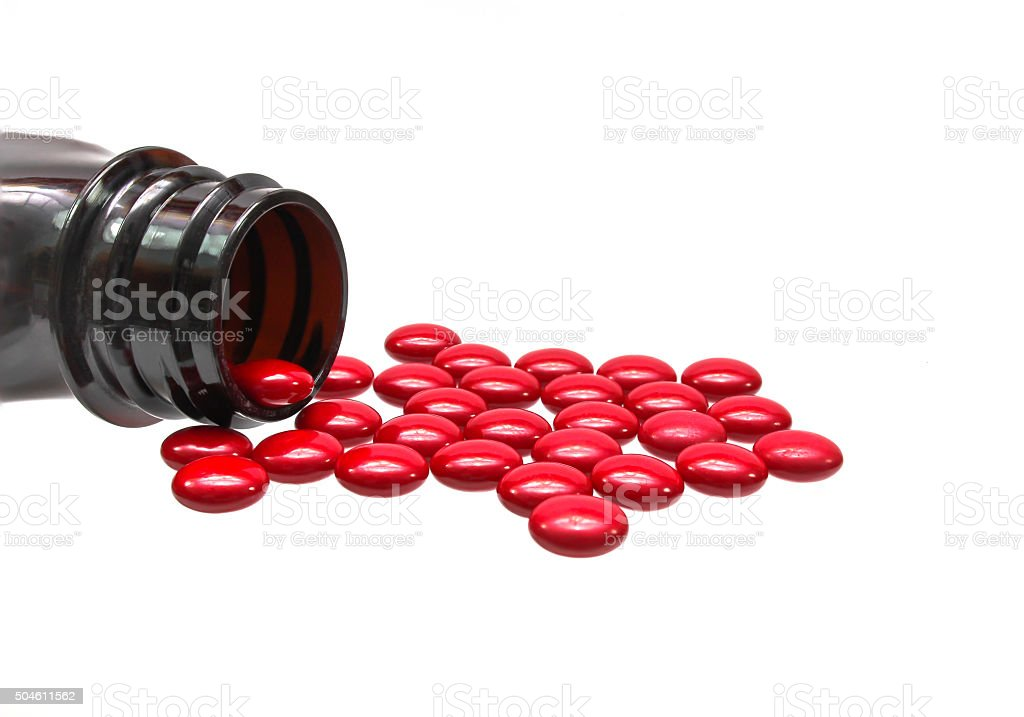 Bottle red pill stock photo