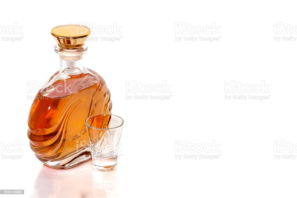 Bottle tequila and shot on white background stock photo