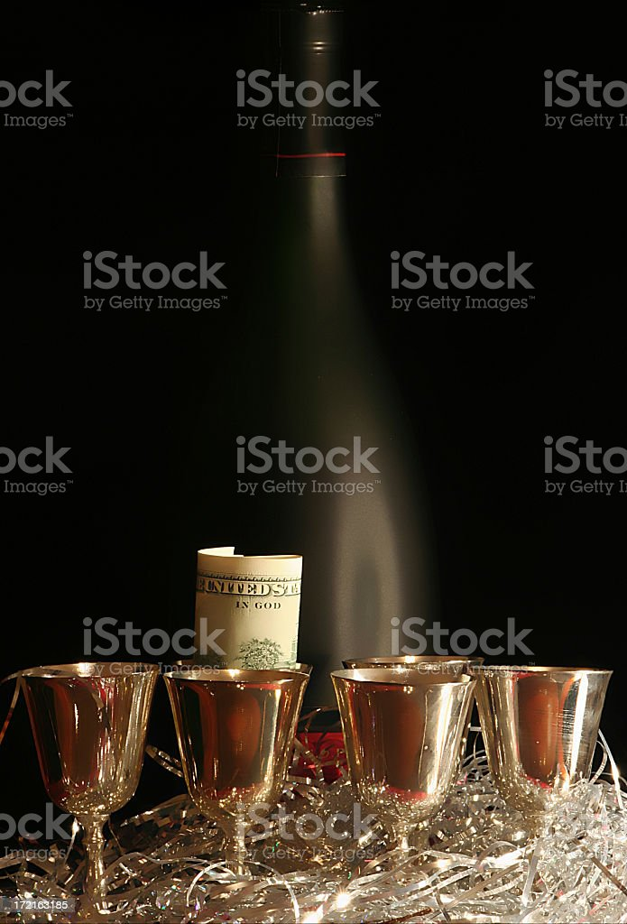 Bottle with 6 bocals. Black background. royalty-free stock photo