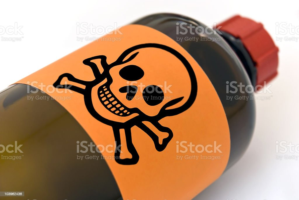 A bottle with an orange poison label stock photo