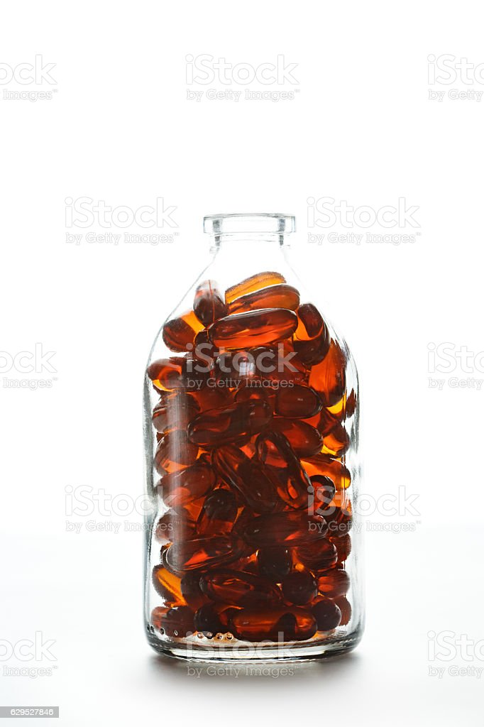 Bottle with gelatin capsules on white background stock photo