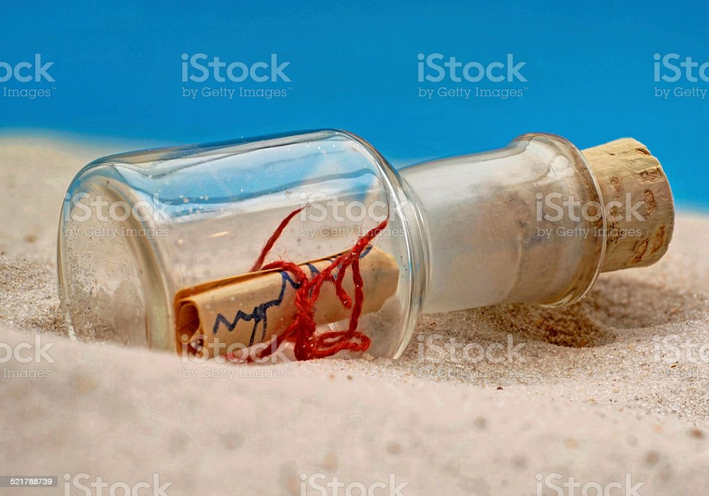 Bottle with letter on the beach stock photo
