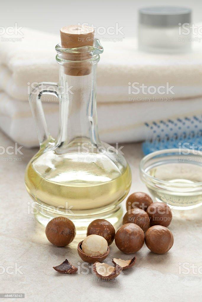 Bottle with macadamia oil stock photo