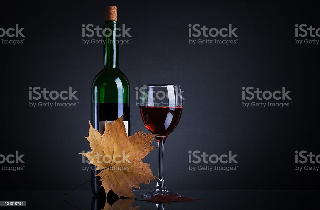 bottle with red wine and glass royalty-free stock photo