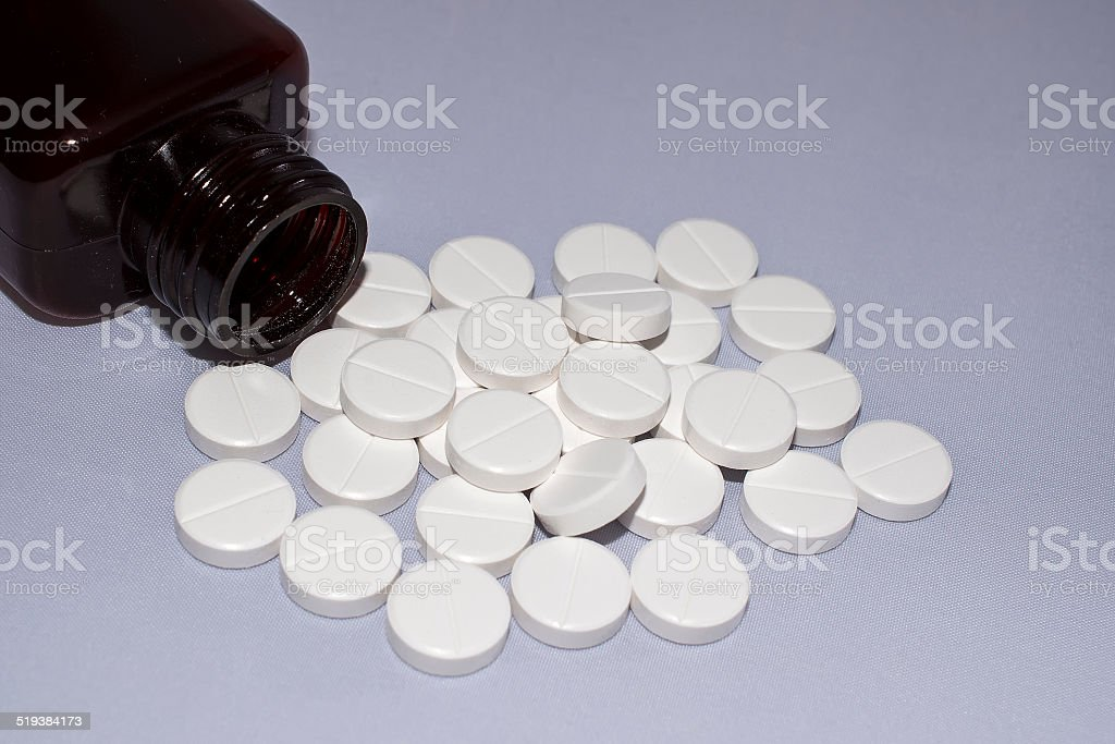 Bottle with white round pills royalty-free stock photo