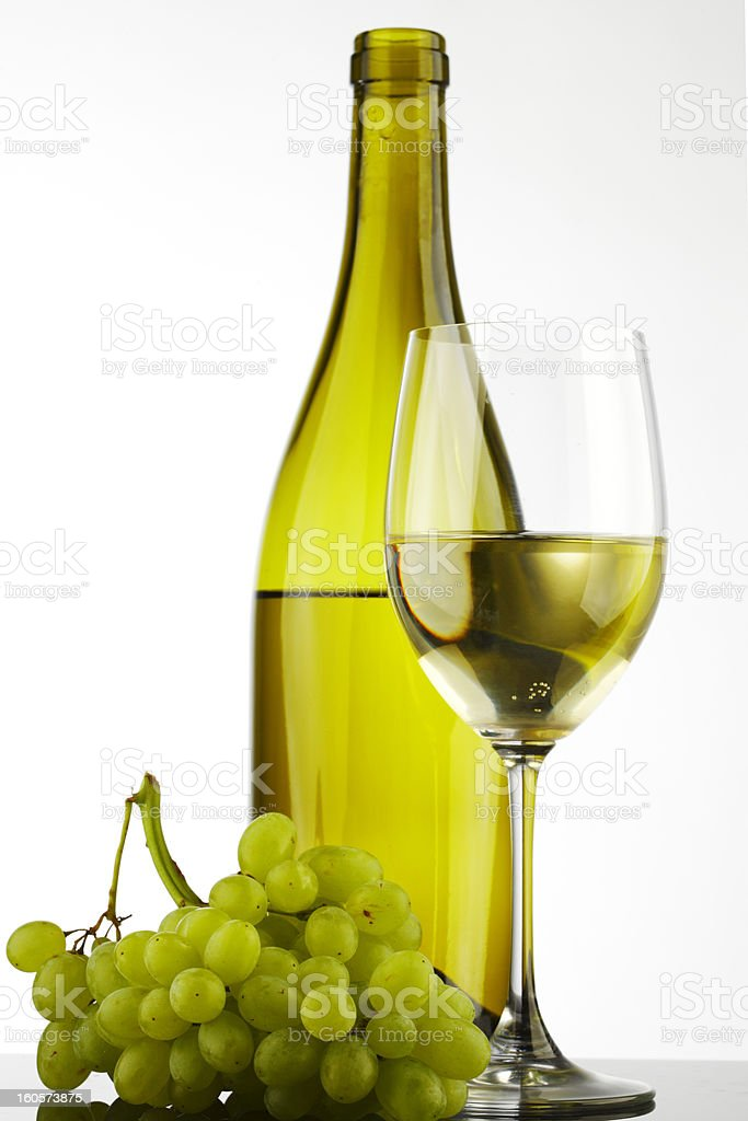 bottle with white wine glass and grapes royalty-free stock photo