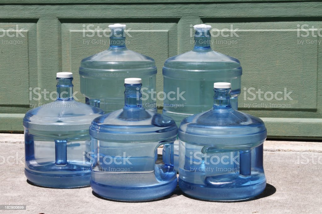 Bottled drinking water in five and three gallon jugs. royalty-free stock photo