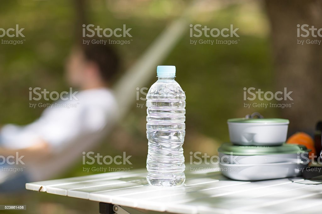 Bottled water on table at camp site stock photo