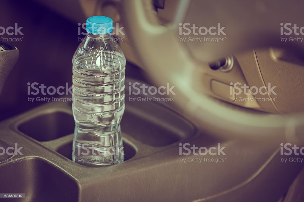 Bottled water was left in car for a long time stock photo