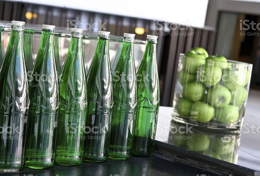 Bottles and apples. royalty-free stock photo
