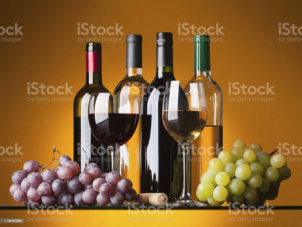 Bottles, glasses and grapes royalty-free stock photo