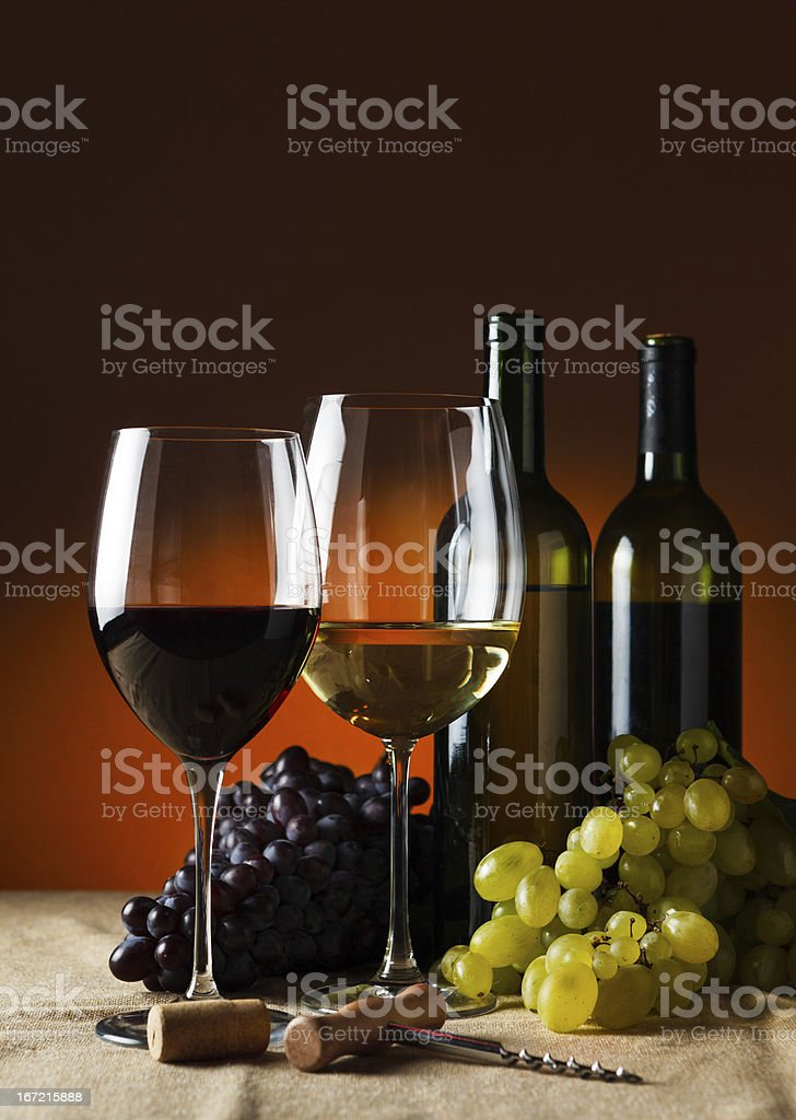 Bottles, glasses of red and white wine royalty-free stock photo
