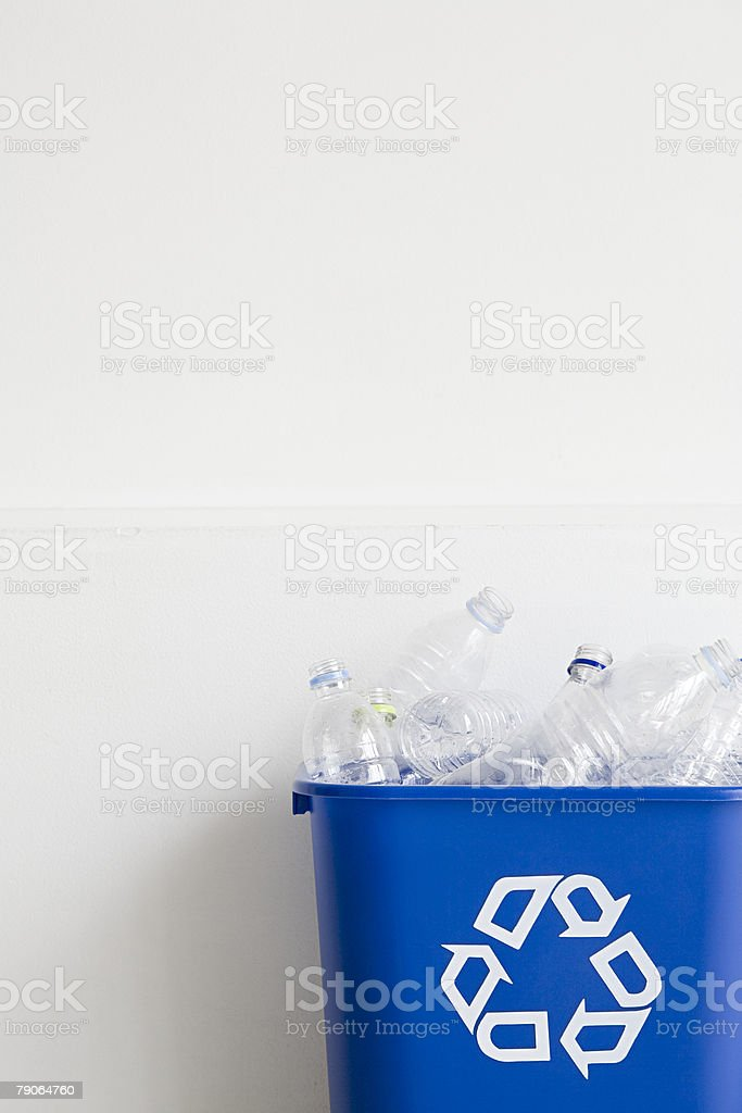 Bottles in a recycling bin royalty-free stock photo