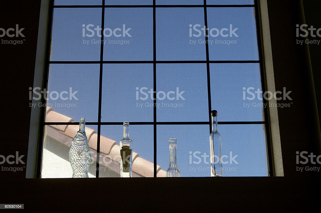 Bottles in a window royalty-free stock photo