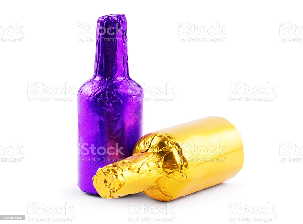 bottles in foil on a white background stock photo