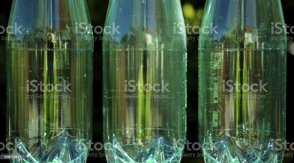 Bottles isolated on nature background royalty-free stock photo