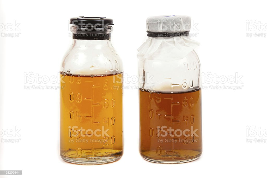 bottles medical with a potion on  white background royalty-free stock photo