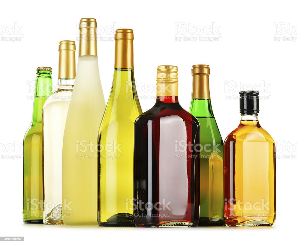Bottles of assorted alcoholic beverages isolated on white royalty-free stock photo