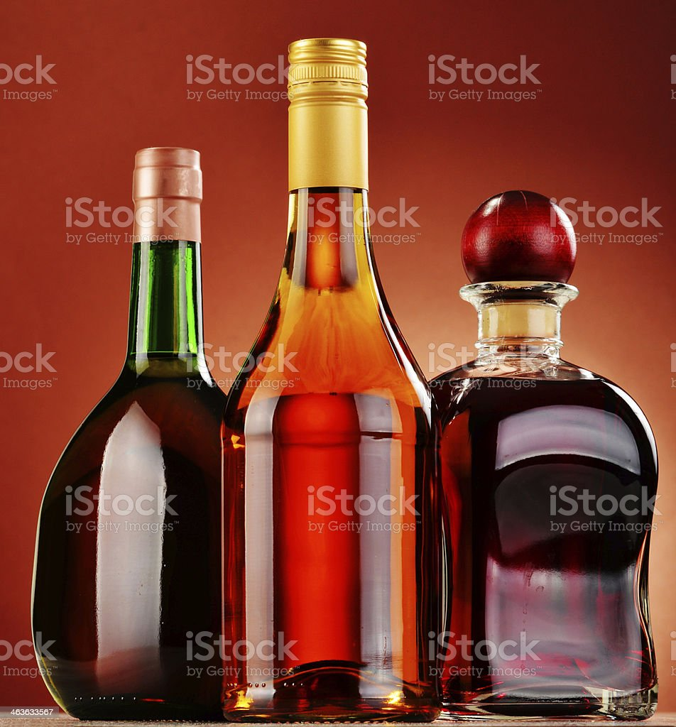 Bottles of assorted alcoholic beverages royalty-free stock photo