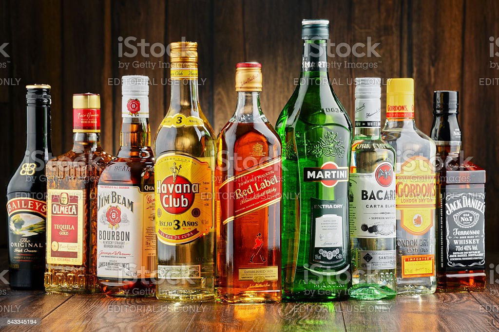 Bottles of assorted hard liquor brands stock photo