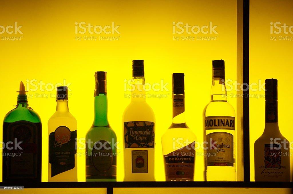 Bottles of assorted liquor brands stock photo