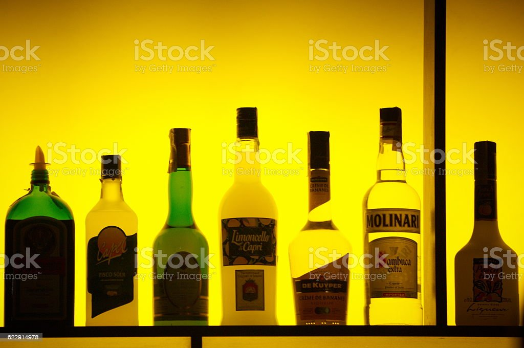 Bottles of assorted liquor brands stock photo