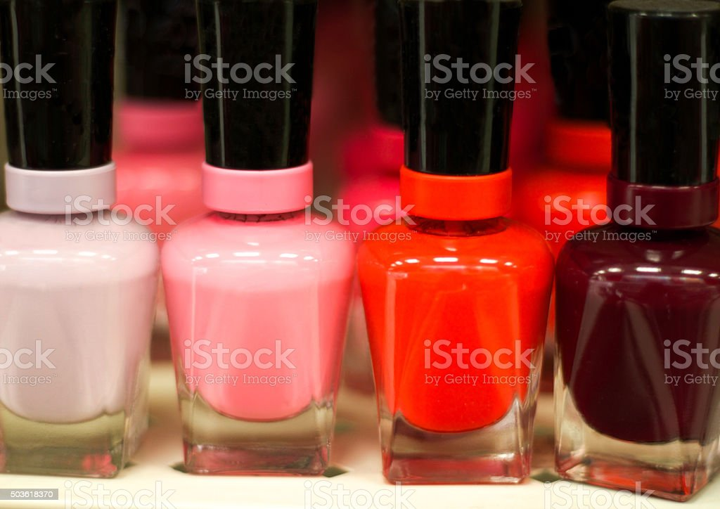 Bottles of Bright Nail Polish in a Row (Close-Up) stock photo