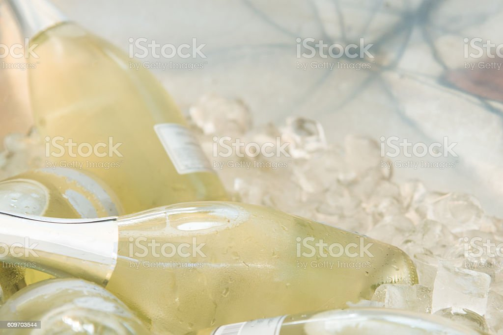 Bottles of champagne in cold ice cubes bucket stock photo