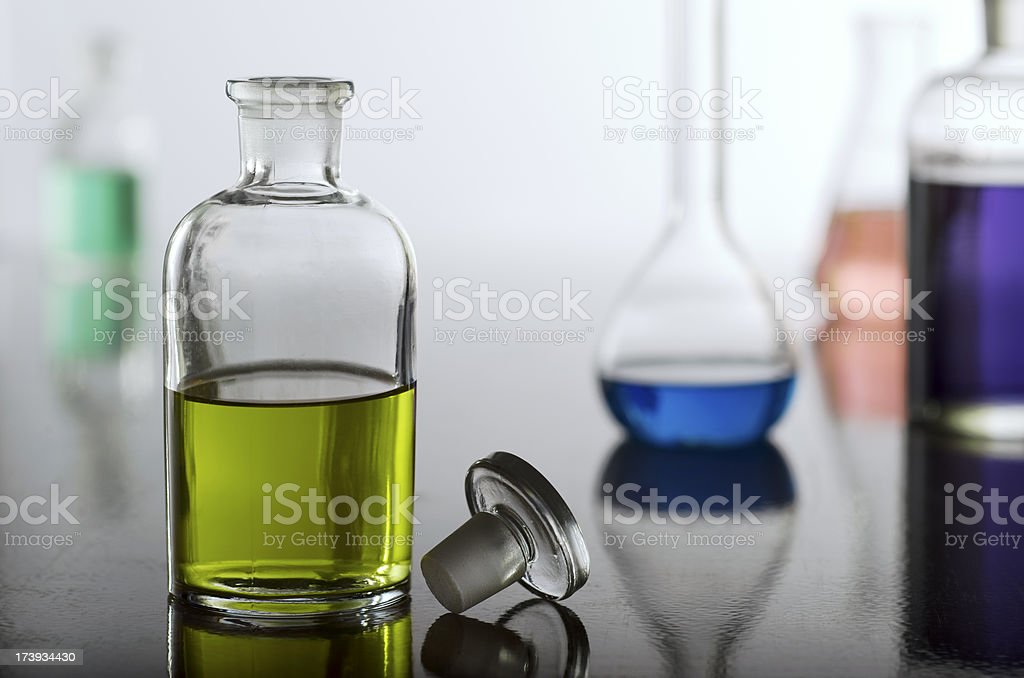 Bottles of Colorful Chemicals in Research Lab, Light Background royalty-free stock photo