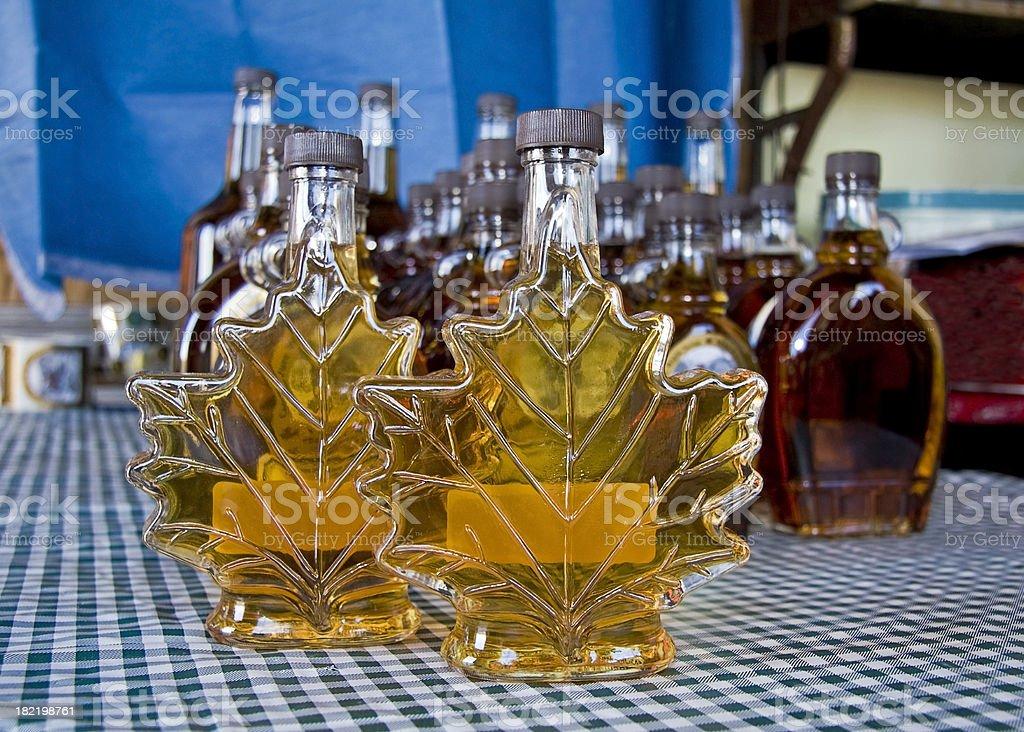 Bottles of fresh maple syrup royalty-free stock photo