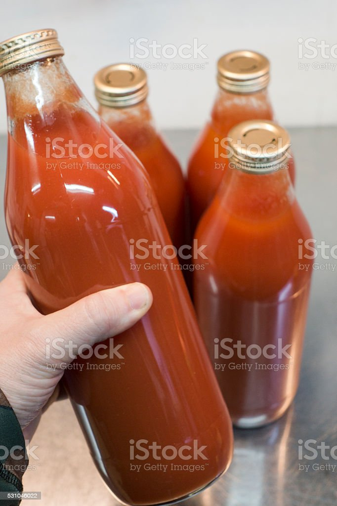Bottles of Fresh Organic Homemade Tomato Sauce or Ketchup stock photo