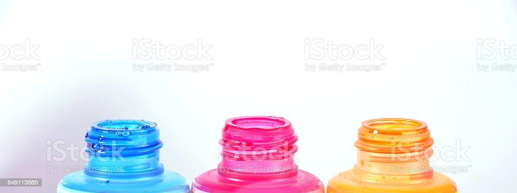 bottles of ink printer cartridges on white background. stock photo
