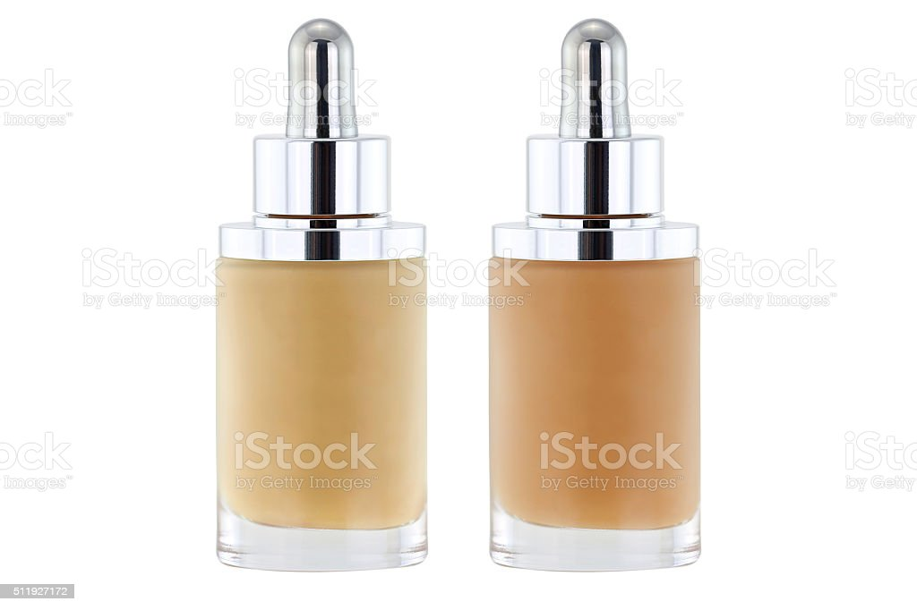 Bottles of liquid foundation with dropper, pink and yellow undertone stock photo