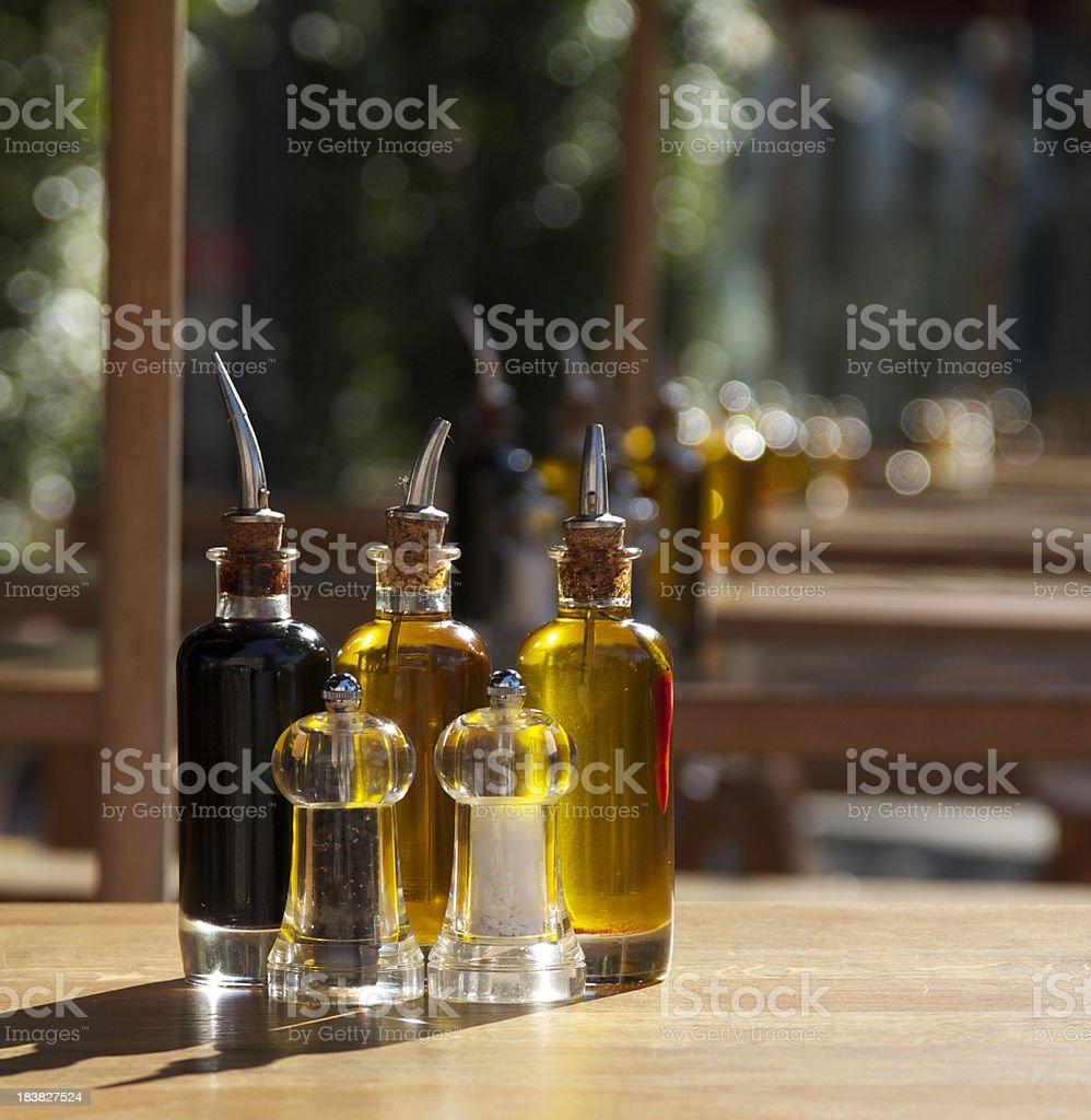 Bottles of olive oil, vinegar, salt and pepper royalty-free stock photo
