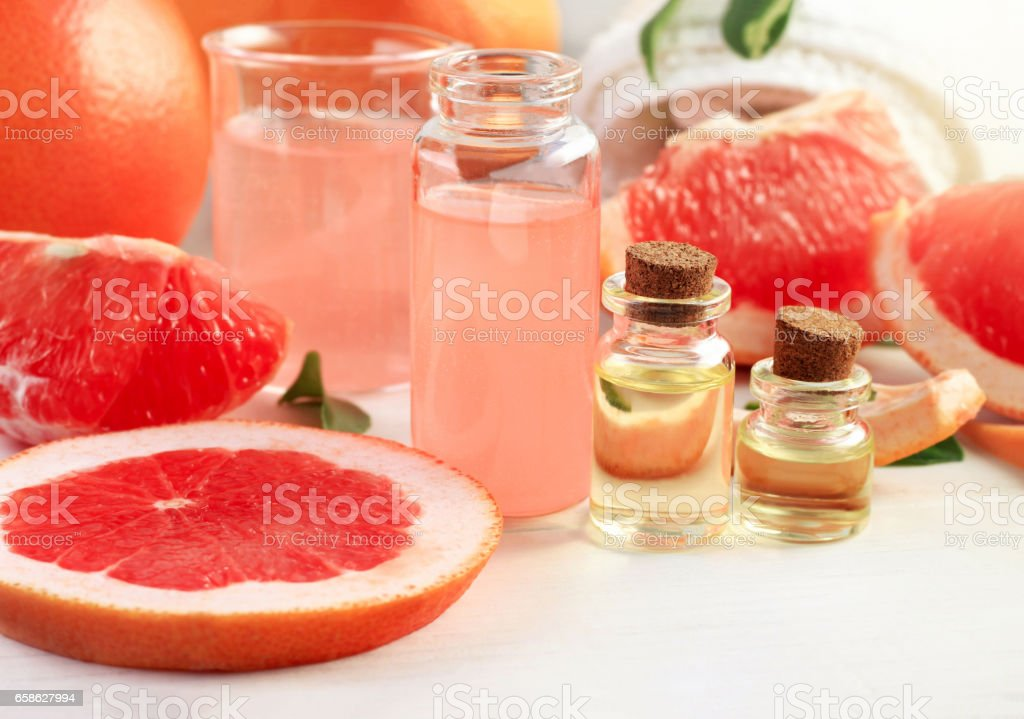 Bottles of pink grapefruit juicy essential oil. stock photo