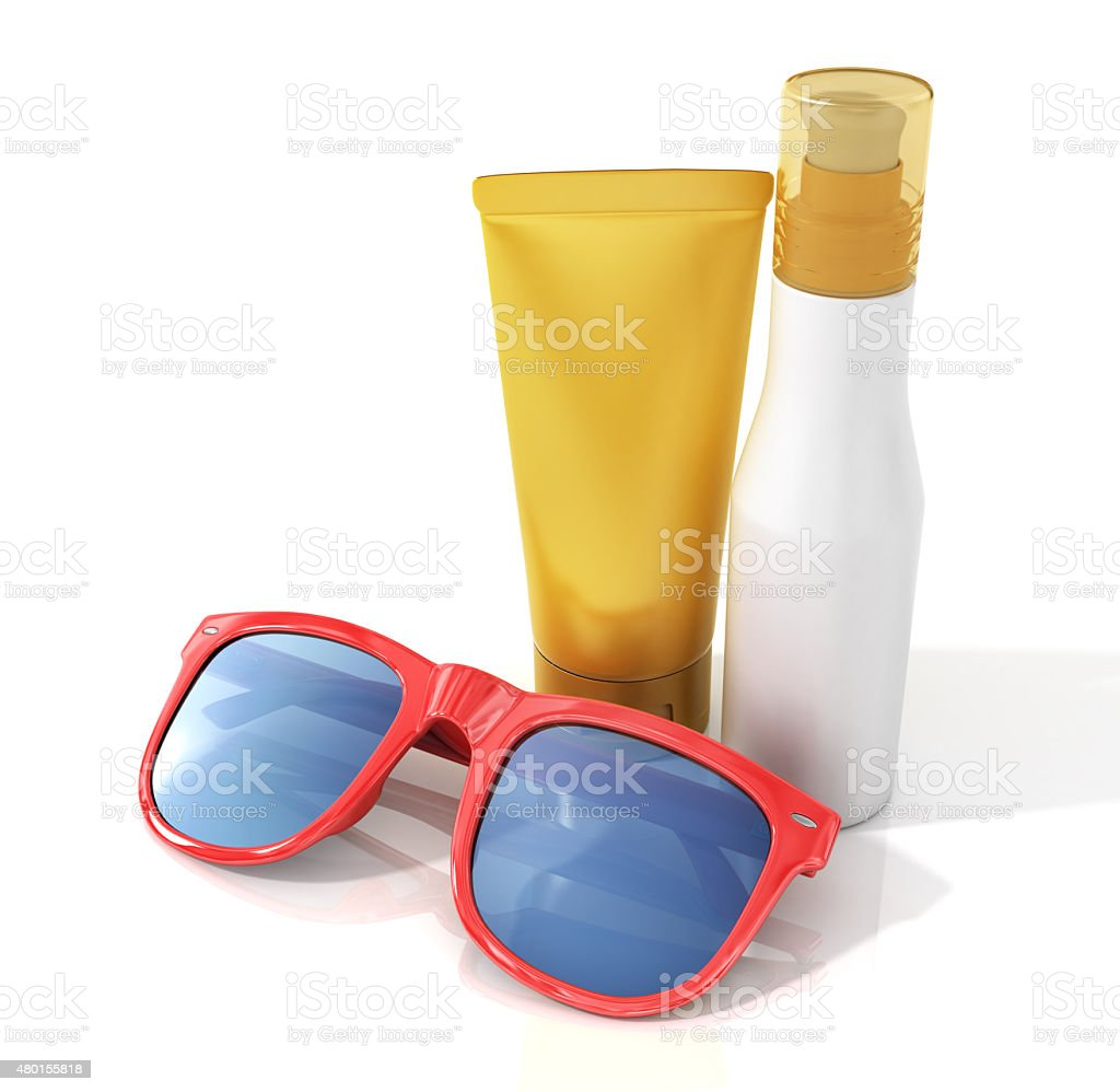 Bottles of suntan cream with sunglasses stock photo