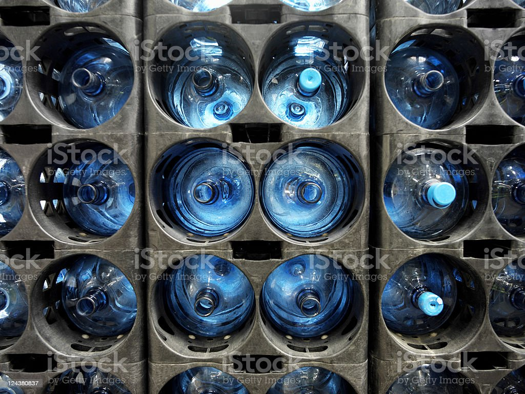 Bottles of water stacked at bottling plant royalty-free stock photo