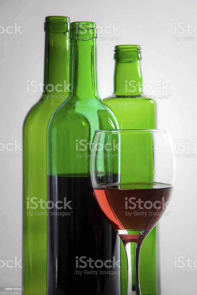 Bottles of wine and Cup royalty-free stock photo