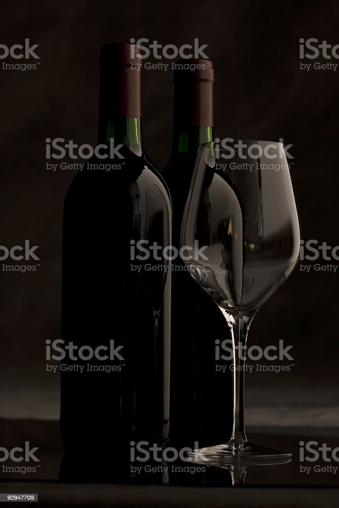 Bottles of wine and glass stock photo