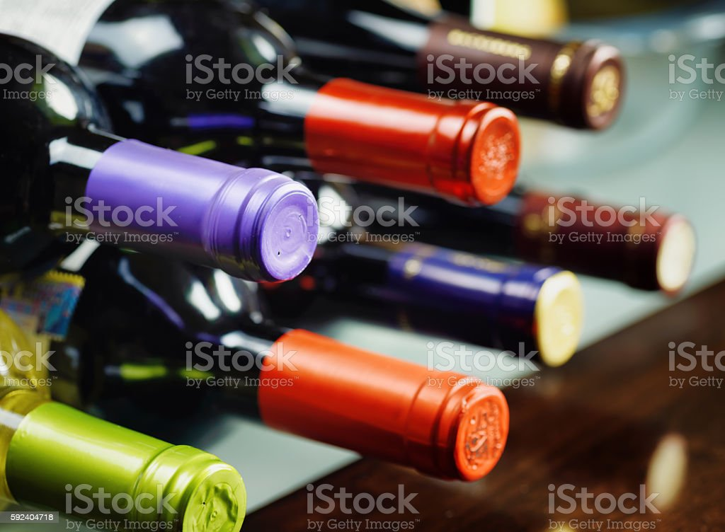 Bottles of wine in a winery. Red and white wine stock photo