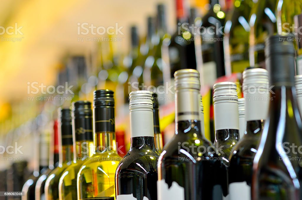 Bottles of wine in rows stock photo