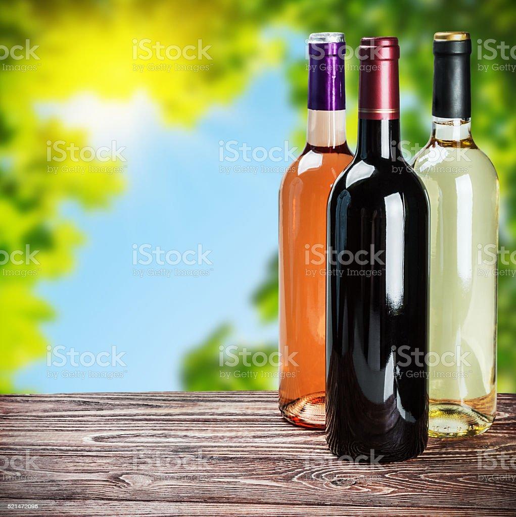 bottles of wine of different sort stock photo