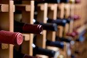 Bottles of wine stirred on a wine rack