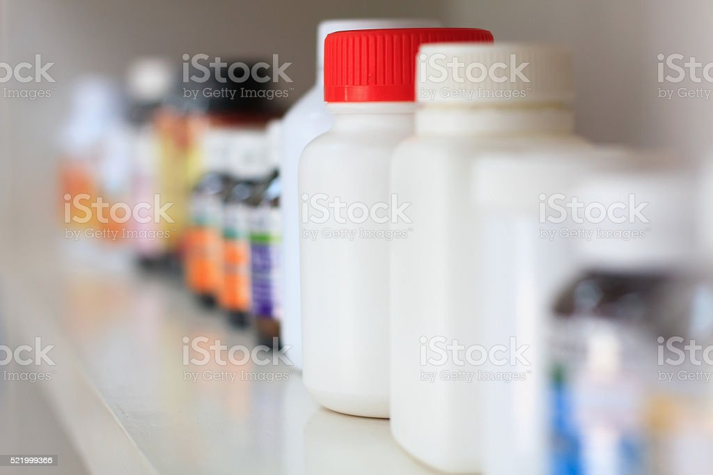 bottles on pharmacy store shelf stock photo