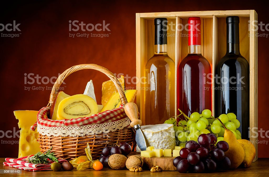 Bottles Wine, Food and Cheese stock photo