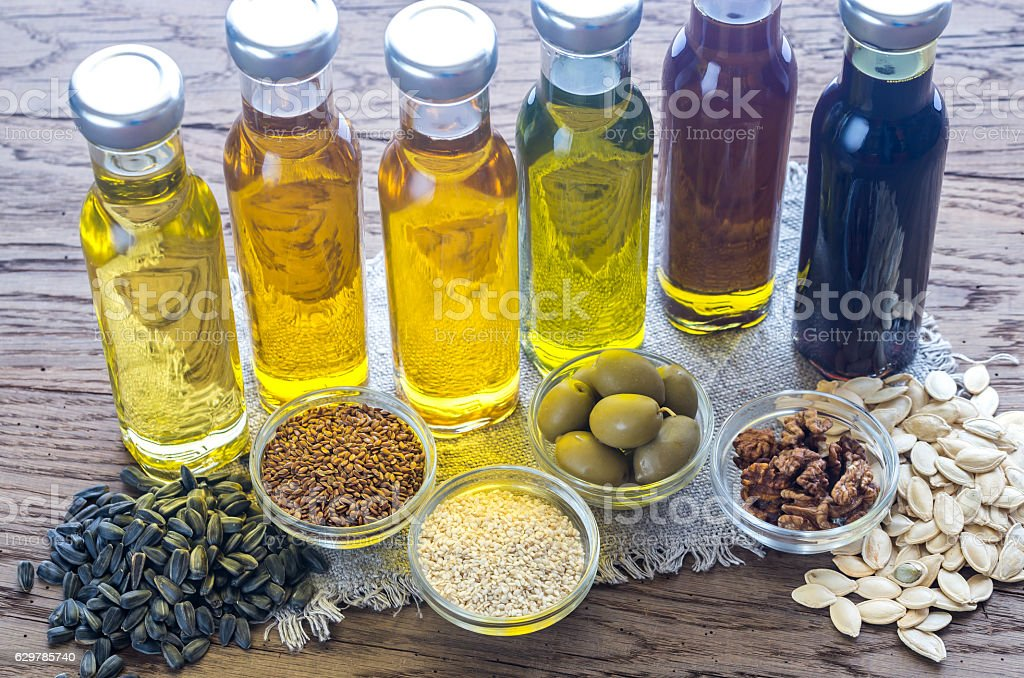 Bottles with different kinds of vegetable oil stock photo
