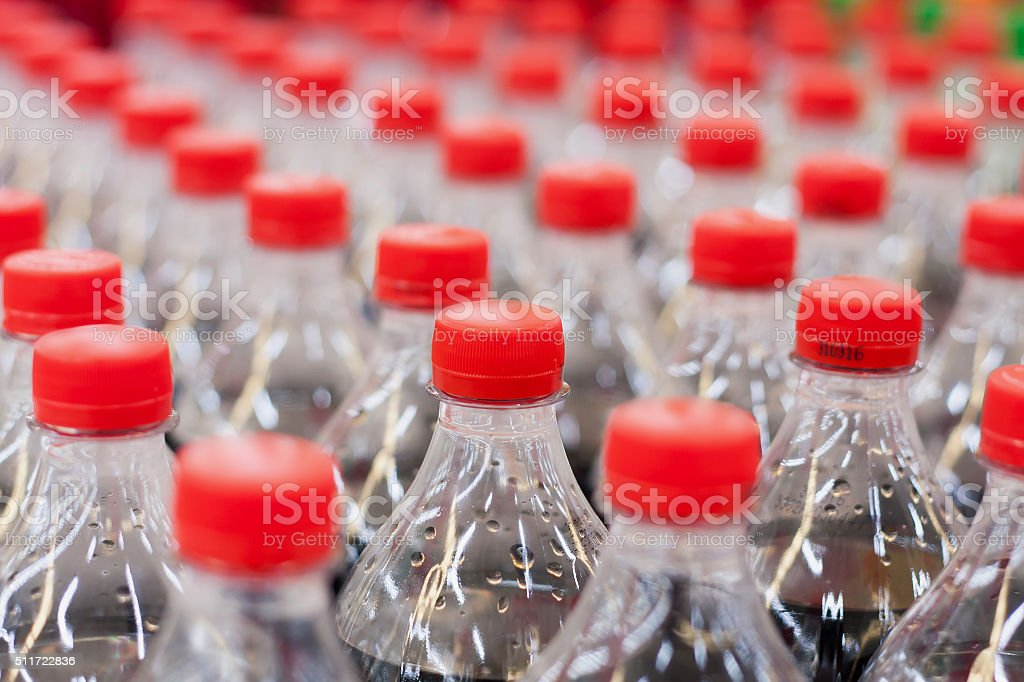 Bottles with soft drinks stock photo