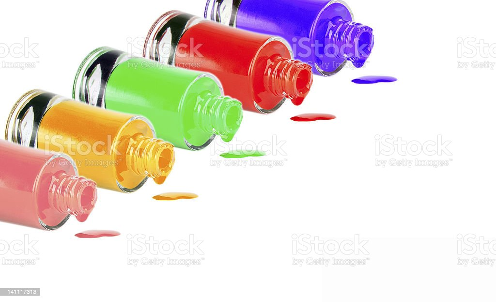 Bottles with spilled nail polish over white background royalty-free stock photo