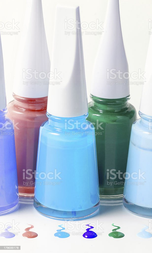 Bottles with spilled nail polish royalty-free stock photo