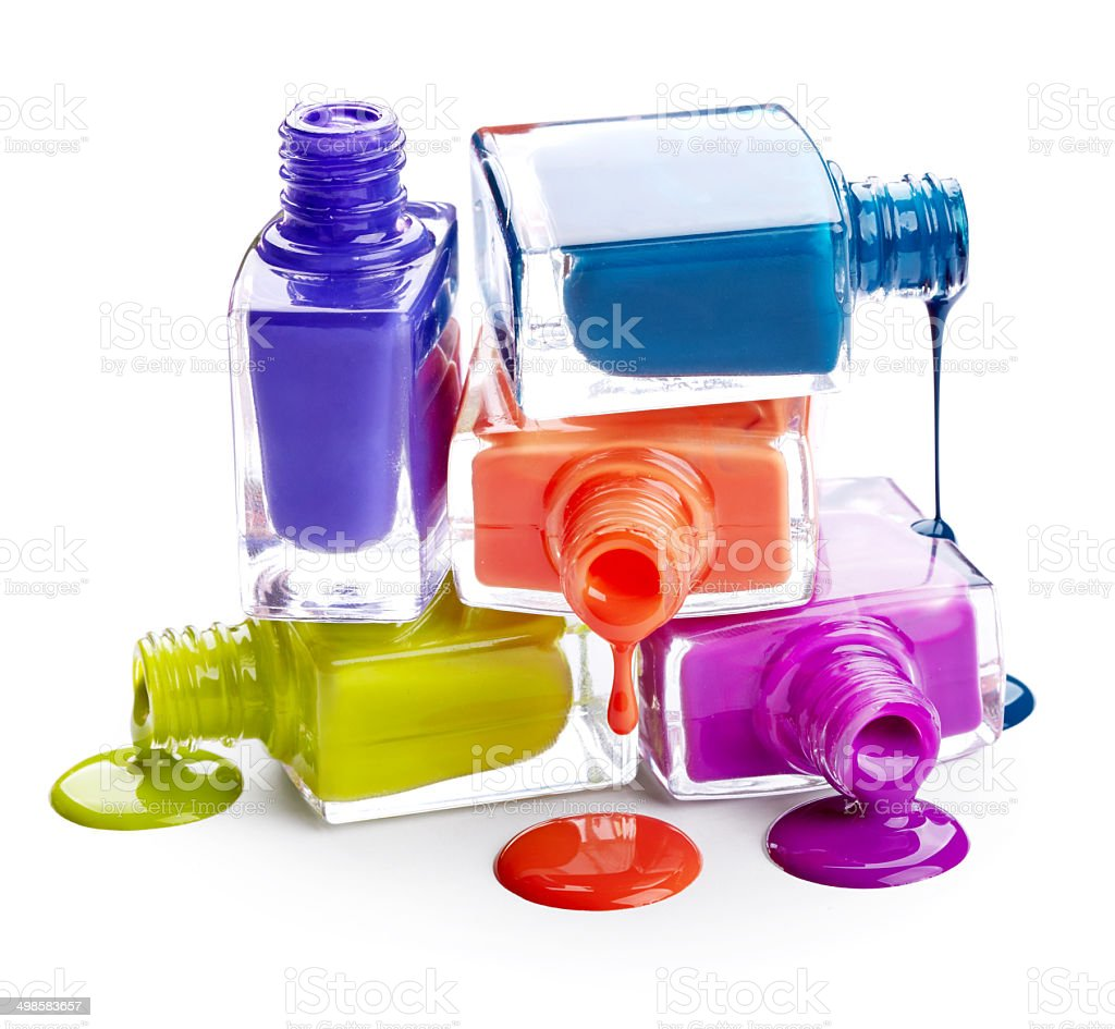 Bottles with spilled nail polish stock photo